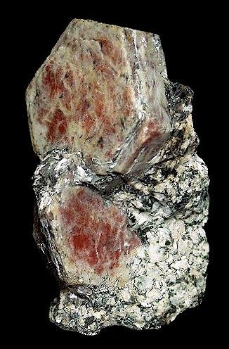 Corundum ( var. Ruby )  Sagstuen Farsjø Årnes, Akershus Fylke (Province) Norway  5.5 x 3.1 cm overall 3.0 cm crystal (Author: GneissWare)