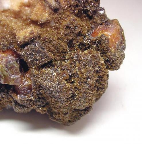 3655-Wulfenita y vanadinita, mina Erupción, Sierra de Los Lamentos, Chihuahua, México, detalle. (Autor: Edelmin)