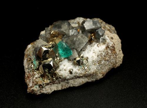 Beryl (variety emerald), Albite (variety cleavelandite), Pyrite, Calcite<br />Chivor mining district, Municipio Chivor, Eastern Emerald Belt, Boyacá Department, Colombia<br />47x16x29mm, xl=4mm<br /> (Author: Fiebre Verde)