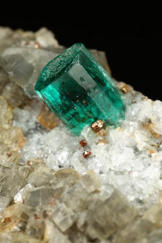 Beryl (variety emerald), Albite (variety cleavelandite), Calcite, Pyrite<br />Chivor mining district, Municipio Chivor, Eastern Emerald Belt, Boyacá Department, Colombia<br />51x18x21mm, xl=5mm<br /> (Author: Fiebre Verde)