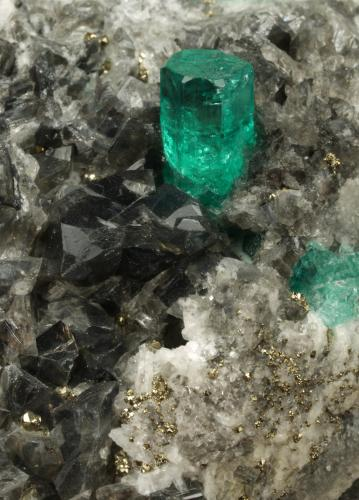 Beryl (variety emerald), Calcite, Dolomite, Pyrite<br />Chivor mining district, El Acuario Mine, Municipio Chivor, Eastern Emerald Belt, Boyacá Department, Colombia<br />84x43x54mm, xl=7mm<br /> (Author: Fiebre Verde)