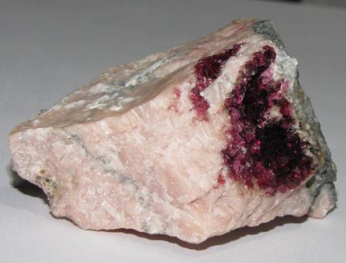 Roselite on pink calcite from Bou Azzer area, near Ouarzazate, Morrocco.  6.1 x 4.3 x 3.6 specimen.  From the 2009 Munich show. (Author: Tracy)