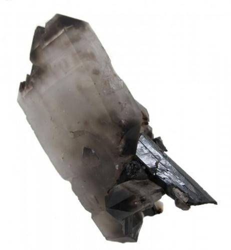 Aegirine, quartz, zircon, feldspar Mount Malosa, Zomba District, Malawi 107 mm x 102 mm x 57 mm. Main aegirine crystal: 92 mm long, 12 mm wide. Main quartz crystal: 116 mm long, 55 mm wide, 13 mm thick (Author: Carles Millan)