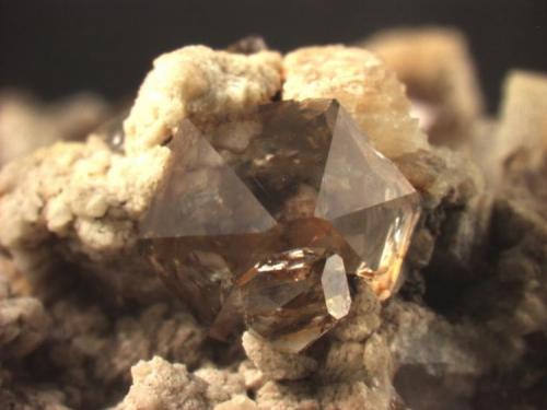 """Quartz, transparent and """"smoky"""". These crystals have very reduced prism faces. Huron River near Milan, OH Main crystal is 5.3 mm wide. (Author: Pete Richards)"""