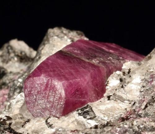 Corundum var. Ruby. Mysore District, Karnataka, India. 50 x 45 x 40 mm, main crystal 25 mm long.  (Photo © by vendor and previous owner Klaus Krause) (Author: Tobi)