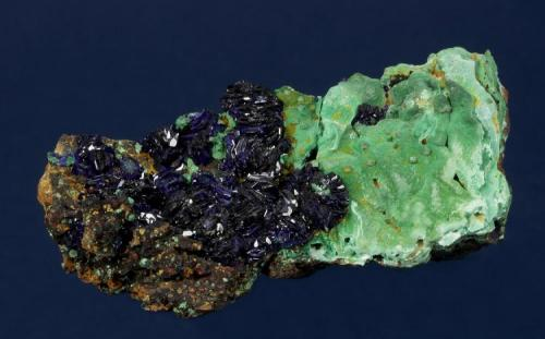 Azurite with Malachite Copper Queen Mine, Warren District, near Bisbee, Cochise County, Arizona, USA 73 x 32 x 27 mm Numerous, lustrous, dark blue Azurite rosettes to 10 mm cover half of the specimen. Light green Malachite completely covers the other half of the specimen. The specimen is circa 1957. Formerly in Tom Hales personal collection. (Author: GneissWare)