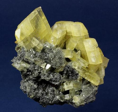 Barite  SSX (South Saval Extension) Mine, Elko County, Nevada, USA  95 x 91 x 73 mm  Translucent, pale-golden, lustrous, thick tabular Barite crystals, the largest measuring 42 x 8 mm, are perched on a contrasting sulfide matrix. Mined in 2001. (Author: GneissWare)