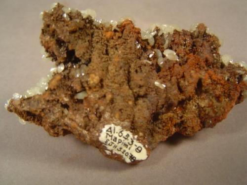 """Mixonite"", Mina Ojuela, Mapimi, Durango, Mexico.  Backside of specimen in previous photograph.  This was acquired in 1978, as can be seen from the affixed label.  I see that I acquired the piece on my birthday that year. (Author: Ed Huskinson)"