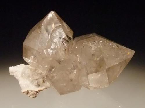 Quartz Lechang Mine, Shaoguan Prefecture, Gandong Prov, China 7x5cm This is very similar to the quartz known as Herkimer Diamonds, all double terminated on a small shard of matrix (Author: Greg Lilly)