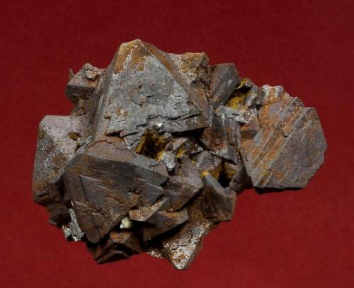 Magnetite Hercules Mine, Municipio de Camargo, Chihuahua, Mexico 69 x 55 x 33 mm  Black, octahedral Magnetite crystals to 25 mm are intergrown and lightly accented by rusty-red Hematite. In excellent conditon, this specimen was self collected during the 1993 Grossular collecting trip Graham and I took. The outcrop lies just outside the mine, and was pointed out to us by Felix who was a mining engineer at the Hercules mine, following some exploratory blasting. (Author: GneissWare)