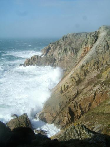 'Devil's Slide' - Lundy Island's most famous rock climb goes up the inclined slab of granite; the climb is approx. 400ft (120m). On this day the wind was near hurricane force, and the waves were enormous - so unsurprisingly we didn't climb it ! (Author: Mike Wood)