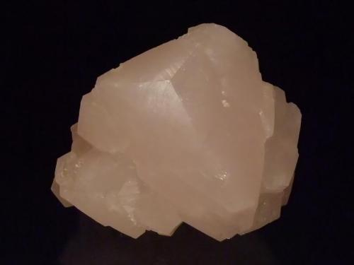 Calcite Verkhnii Mine, Dal'negorsk, Primorskiy Kray, Russia 13x10.5x10.5 cm A large light pink calcite, the prism faces are all complete but two of them are roughly formed. Collected 2012. (Author: Greg Lilly)