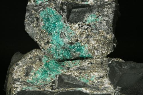 Beryl (variety emerald) with Pyrite<br />La Pita mining district, Municipio Maripí, Western Emerald Belt, Boyacá Department, Colombia<br />Detail - FOV 12cm<br /> (Author: Fiebre Verde)