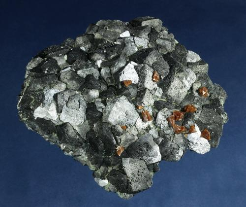 Genthelvite on Magnetite<br />Huanggang Mines, Hexigten Banner (Kèshíkèténg Qí), Ulanhad (Chifeng), Inner Mongolia Autonomous Region, China<br />108 x 97 x 30 mm<br /> (Author: GneissWare)