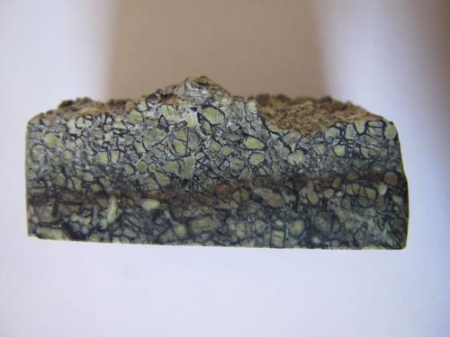 Komatiita<br />Formación Komati, Barberton Greenbelt, Sudáfrica<br />3''5 x 1''5 cm.<br /> (Autor: prcantos)