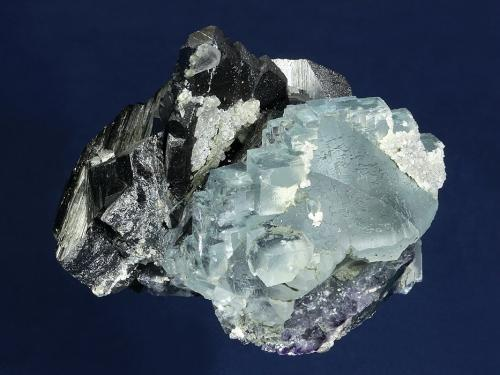 Ferberite with Fluorite<br />Yaogangxian Mine, Yizhang, Chenzhou Prefecture, Hunan Province, China<br />84 x 75 x 55 mm<br /> (Author: GneissWare)