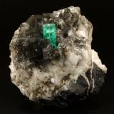 Beryl (variety emerald), Calcite, Pyrite<br />La Pita mining district, Cunas Mine, Municipio Maripí, Western Emerald Belt, Boyacá Department, Colombia<br />50x50x45mm, xl=11x7mm<br /> (Author: Fiebre Verde)