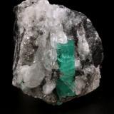 Beryl (variety emerald), Calcite<br />La Pita mining district, Polveros Mine, Municipio Maripí, Western Emerald Belt, Boyacá Department, Colombia<br />41x52x59mm, xl=26x9mm<br /> (Author: Fiebre Verde)