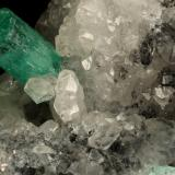 Beryl (variety emerald), Calcite<br />La Pita mining district, Polveros Mine, Municipio Maripí, Western Emerald Belt, Boyacá Department, Colombia<br />45x32x28mm, xl=18x7mm<br /> (Author: Fiebre Verde)