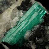 Beryl (variety emerald), Calcite<br />Muzo mining district, Western Emerald Belt, Boyacá Department, Colombia<br />58x31x34mm, xl aggregate=25x8mm<br /> (Author: Fiebre Verde)