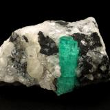 Beryl (variety emerald), Calcite<br />Muzo mining district, Western Emerald Belt, Boyacá Department, Colombia<br />58x31x34mm, crystal aggregate=25x8mm<br /> (Author: Fiebre Verde)