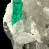 Beryl (variety emerald), Calcite<br />La Pita mining district, Municipio Maripí, Western Emerald Belt, Boyacá Department, Colombia<br />35x38x37mm, main xl=12x4mm<br /> (Author: Fiebre Verde)