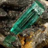 Beryl (variety emerald), Calcite<br />Muzo mining district, Western Emerald Belt, Boyacá Department, Colombia<br />62x27x39mm, original xl=25mm<br /> (Author: Fiebre Verde)