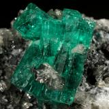 Beryl (variety emerald), Calcite<br />La Pita mining district, Municipio Maripí, Western Emerald Belt, Boyacá Department, Colombia<br />27x40x31mm, aggregate=15x13mm<br /> (Author: Fiebre Verde)