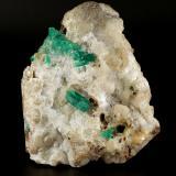 Beryl (variety emerald), Calcite, Quartz<br />Peñas Blancas Mine, Municipio San Pablo de Borbur, Western Emerald Belt, Boyacá Department, Colombia<br />105x130x50mm, largest xl=18mm<br /> (Author: Fiebre Verde)