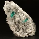 Beryl (variety emerald), Calcite, Dolomite, Pyrite<br />Chivor mining district, Municipio Chivor, Eastern Emerald Belt, Boyacá Department, Colombia<br />78x40x34mm, xls=12 & 11mm<br /> (Author: Fiebre Verde)