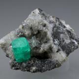 Beryl (variety emerald), Calcite, Dolomite, Pyrite<br />Coscuez mining district, Municipio San Pablo de Borbur, Western Emerald Belt, Boyacá Department, Colombia<br />27x24x35mm, xl=9x6mm<br /> (Author: Fiebre Verde)