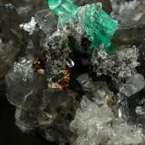 Beryl (variety emerald), Calcite, Dolomite, Pyrite, Quartz<br />La Pita mining district, Cunas Mine, Municipio Maripí, Western Emerald Belt, Boyacá Department, Colombia<br />66x49x24mm, main xl=6x4mm<br /> (Author: Fiebre Verde)