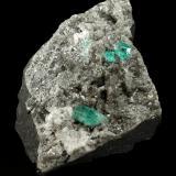 Beryl (variety emerald), Calcite, Dolomite<br />Chivor mining district, Municipio Chivor, Eastern Emerald Belt, Boyacá Department, Colombia<br />87x64x61mm, largest xl=5mm<br /> (Author: Fiebre Verde)