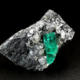 Beryl (variety emerald), Calcite, Dolomite, Pyrite<br />La Pita mining district, Cunas Mine, Municipio Maripí, Western Emerald Belt, Boyacá Department, Colombia<br />41x31x25mm, xl=17mm<br /> (Author: Fiebre Verde)