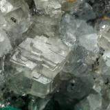 Beryl (variety emerald), Calcite, Dolomite, Pyrite<br />La Pita mining district, Polveros Mine, Municipio Maripí, Western Emerald Belt, Boyacá Department, Colombia<br />27x30x33mm, xl=9x6mm<br /> (Author: Fiebre Verde)