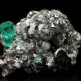 Beryl (variety emerald), Calcite<br />La Pita mining district, Municipio Maripí, Western Emerald Belt, Boyacá Department, Colombia<br />27x34x10mm, xl=10x4.5mm<br /> (Author: Fiebre Verde)