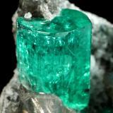 Beryl (variety emerald), Albite (variety cleavelandite), Dolomite<br />La Pita mining district, Cunas Mine, Municipio Maripí, Western Emerald Belt, Boyacá Department, Colombia<br />35x21x16mm, main xl=11x8mm<br /> (Author: Fiebre Verde)