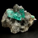 Beryl (variety emerald), Calcite, Pyrite<br />Chivor mining district, Municipio Chivor, Eastern Emerald Belt, Boyacá Department, Colombia<br />38x24x29mm, largest xl=17mm<br /> (Author: Fiebre Verde)