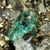 Beryl (variety emerald), Calcite, Pyrite<br />Chivor mining district, El Acuario Mine, Municipio Chivor, Eastern Emerald Belt, Boyacá Department, Colombia<br />33x41x21mm, xl=8mm<br /> (Author: Fiebre Verde)
