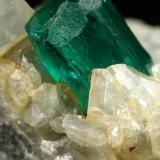 Beryl (variety emerald), Calcite, Dolomite, Pyrite<br />Chivor mining district, Municipio Chivor, Eastern Emerald Belt, Boyacá Department, Colombia<br />50x39x20mm, xl=10mm<br /> (Author: Fiebre Verde)
