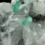 Beryl (variety emerald), Calcite<br />La Pita mining district, Municipio Maripí, Western Emerald Belt, Boyacá Department, Colombia<br />49x44x36mm, xls=6 & 4mm<br /> (Author: Fiebre Verde)
