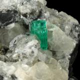 Beryl (variety emerald), Calcite, Pyrite<br />Muzo mining district, Western Emerald Belt, Boyacá Department, Colombia<br />65x90x85mm, aggregate=14x9mm<br /> (Author: Fiebre Verde)