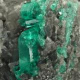 Beryl (variety emerald), Calcite, Dolomite<br />La Pita mining district, Municipio Maripí, Western Emerald Belt, Boyacá Department, Colombia<br />120x83x68mm, main xl=14mm<br /> (Author: Fiebre Verde)