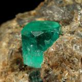 Beryl (variety emerald), Calcite, Dolomite, Pyrite<br />Chivor mining district, Municipio Chivor, Eastern Emerald Belt, Boyacá Department, Colombia<br />33x37x40mm, xl=8mm<br /> (Author: Fiebre Verde)