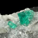 Beryl (variety emerald), Calcite, Quartz<br />Muzo mining district, Western Emerald Belt, Boyacá Department, Colombia<br />43x68x27mm, largest xl=8mm<br /> (Author: Fiebre Verde)