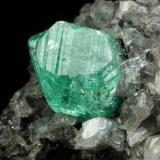 Beryl (variety emerald), Calcite, Dolomite<br />La Pita mining district, Municipio Maripí, Western Emerald Belt, Boyacá Department, Colombia<br />39x24x18mm, xl=9mm<br /> (Author: Fiebre Verde)