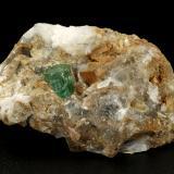 Beryl (variety emerald), Calcite<br />La Pita mining district, Polveros Mine, Municipio Maripí, Western Emerald Belt, Boyacá Department, Colombia<br />46x25x30mm, xl=7x7mm<br /> (Author: Fiebre Verde)