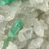Beryl (variety emerald), Calcite<br />La Pita mining district, Municipio Maripí, Western Emerald Belt, Boyacá Department, Colombia<br />46x85x20mm, xls=26, 16 & 13mm<br /> (Author: Fiebre Verde)