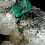Beryl (variety emerald), Calcite<br />Coscuez mining district, Municipio San Pablo de Borbur, Western Emerald Belt, Boyacá Department, Colombia<br />59x20x60mm, xl=7x5mm<br /> (Author: Fiebre Verde)