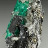 Beryl (variety emerald), Calcite, Pyrite<br />Coscuez mining district, Calceteros Mine, Municipio San Pablo de Borbur, Western Emerald Belt, Boyacá Department, Colombia<br />29x45x27mm, xl=34mm<br /> (Author: Fiebre Verde)